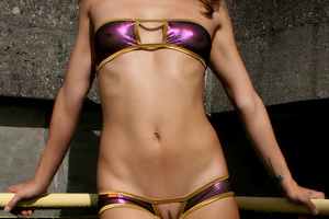 Jasmin wears Antisocial (Gold/Metalmesh Purple)